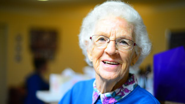 Old lady in blue jumper who has passed the optimum age for non-surgical eye lift treatment