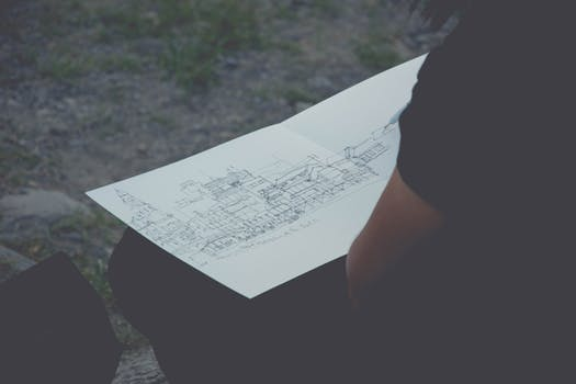 Man looking at house plans before starting structural repairs