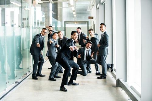 Group of men in suits in office building corridor post office refurbishment Glasgow