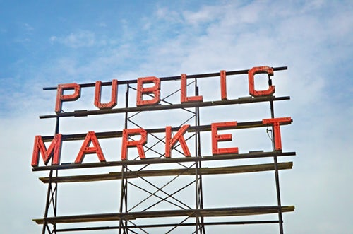 "Large sign reading ""public market"" standing above a marketing trends event"
