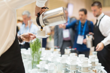 labour agency pouring coffee for clients